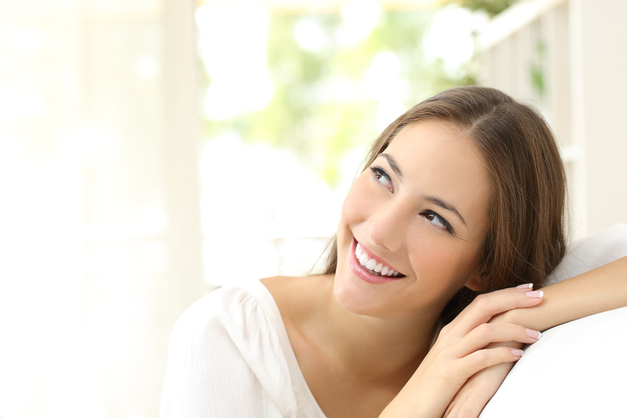 happy woman smiling in living room